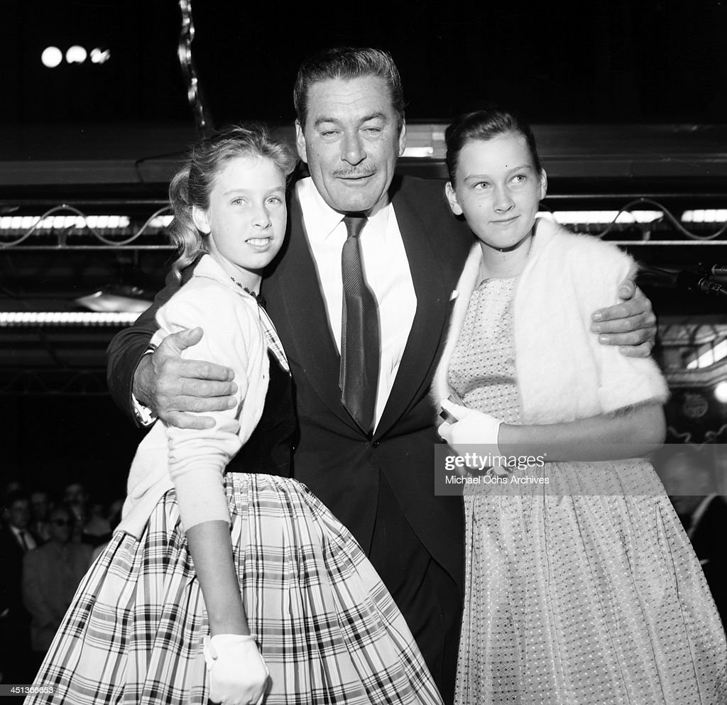 Actor Errol Flynn poses with daughters Deidre 12 and Rory 10