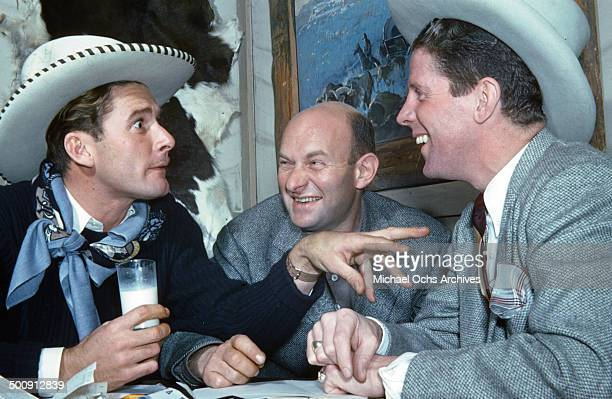 Actor Errol Flynn shares a joke with singer and actor Rudy Vallee while in town for the movie premiere of 'Santa Fe Trail' in December 1940