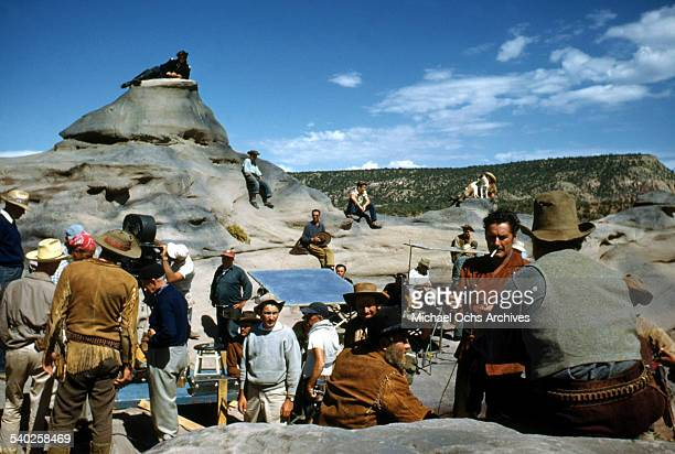 Actor Errol Flynn smokes on set as a film crew films the movie 'Rocky Mountain' on location in Gallop New Mexico Starring Errol Flynn and Patrice...