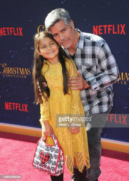 Actor Esai Morales daughter and Mariana Oliveira Morales arrive for the Premiere Of Netflix's The Christmas Chronicles held at Fox Bruin Theater on...