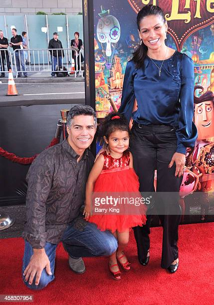 Actor Esai Morales daughter Mariana Oliveira Morales and wife Elvimar Silva arrives at the Los Angeles premiere of 'Book Of Life' held at Regal...