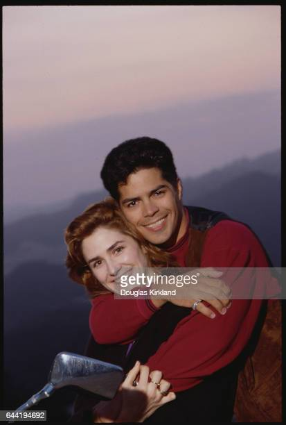 Actor Esai Morales Hugging Woman