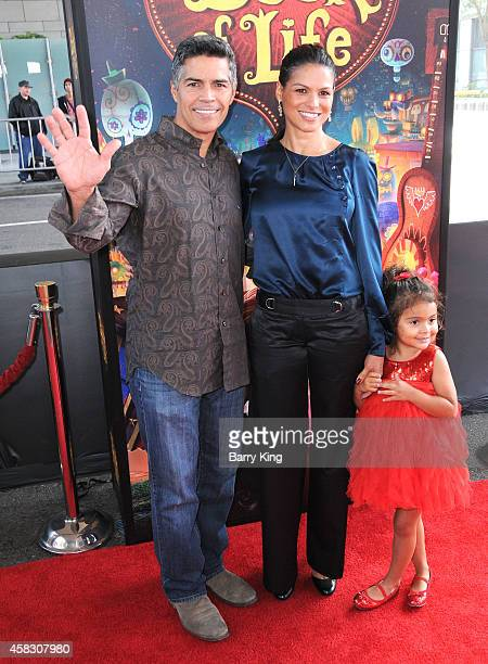 Actor Esai Morales wife Elvimar Silva and daughter Mariana Oliveira Morales arrive at the Los Angeles premiere of 'Book Of Life' held at Regal...
