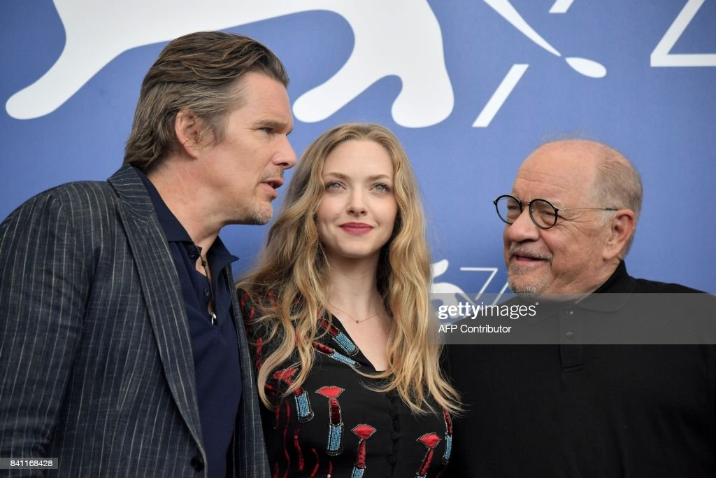 Actor Ethan Hawke (L), actress Amanda Seyfried and director Paul Schrader attend the photocall of the movie 'First Reformed' presented in competition 'Venezia 74' at the 74th Venice Film Festival on August 31, 2017 at Venice Lido. / AFP PHOTO / Tiziana FABI