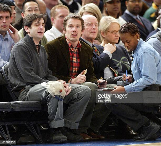 Actor Ethan Hawke and actor Peter Boyle attend a game between the New York Knicks and Dallas Mavericks at Madison Square Garden on December 21 2004...
