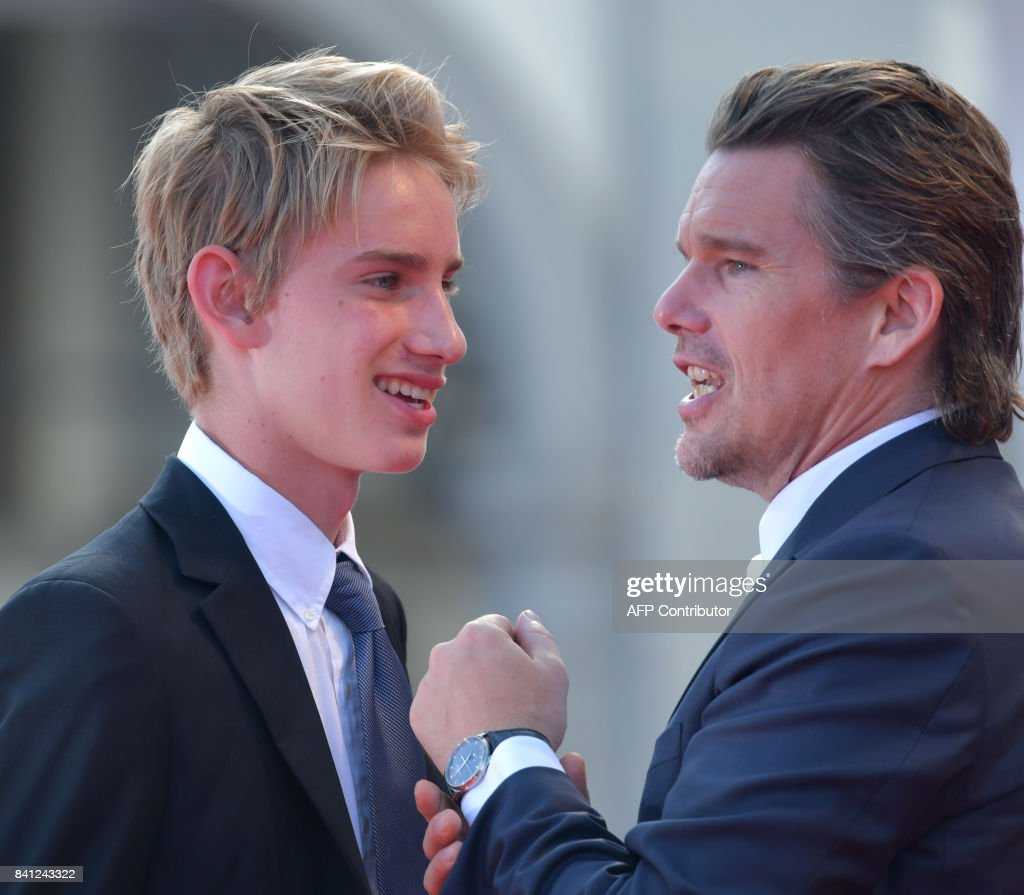 Actor Ethan Hawke (R) and his son Levon Roan Hawke arrive for the premiere of the movie 'First Reformed' presented in competition at the 74th Venice Film Festival on August 31, 2017 at Venice Lido. / AFP PHOTO / Tiziana FABI