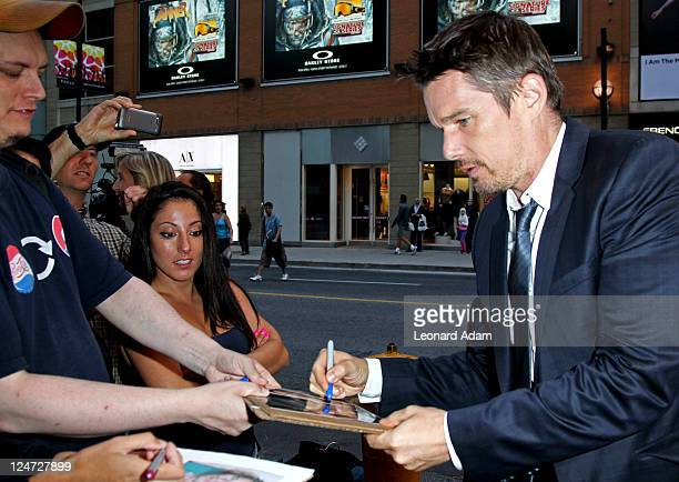 Actor Ethan Hawke signs autographs for fans at the premiere of 'The Woman In The Fifth' at Winter Game Theatre during the 2011 Toronto International...