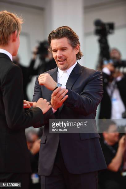 Actor Ethan Hawke wearing a JaegerLeCoultre Master Ultra Thin Moon watch with his son Levon Roan ThurmanHawke walks the red carpet during the 'First...