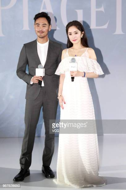 Actor Ethan Juan and actress Yang Mi attend Piaget event on May 11 2018 in Beijing China