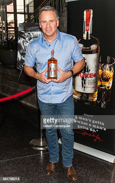 Actor Ethan Wayne son of actor John Wayne signs bottles of Duke Bourbon during 186th PHS Philadelphia Flower Show Celebrate the Movies at...