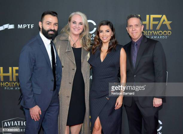 Actor Eva Longoria poses with honorees Adrian Molina Darla K Anderson and Lee Unkrich during the 21st Annual Hollywood Film Awards at The Beverly...
