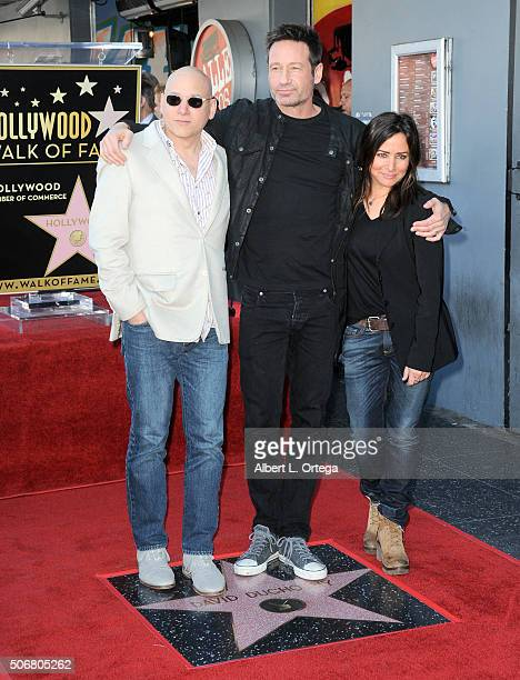 Actor Evan Handler actor David Duchovny and Actress Pamela Adlon at the Star On The Hollywood Walk Of Fame ceremony held on January 25 2016 in...