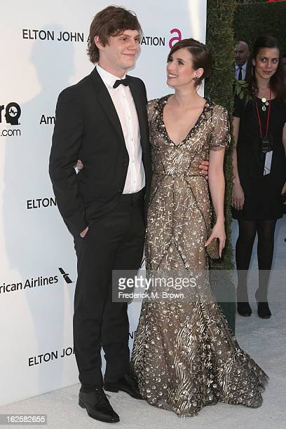 Actor Evan Peters and Actress Emma Roberts arrive at the 21st Annual Elton John AIDS Foundation's Oscar Viewing Party on February 24 2013 in Los...