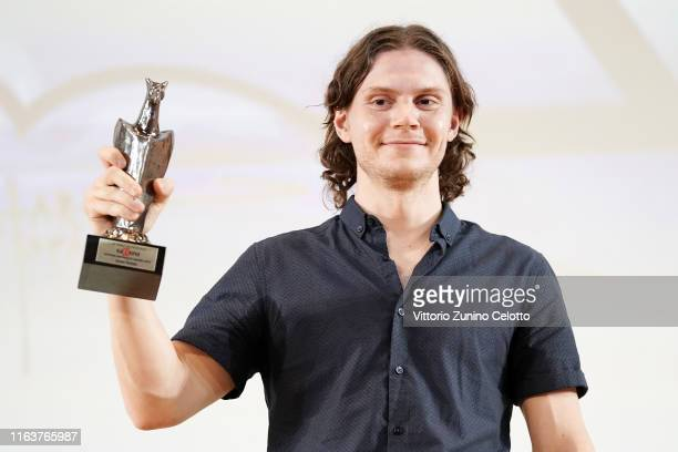 Actor Evan Peters poses with the Giffoni Experience Award during Giffoni Film Festival 2019 on July 23 2019 in Giffoni Valle Piana Italy