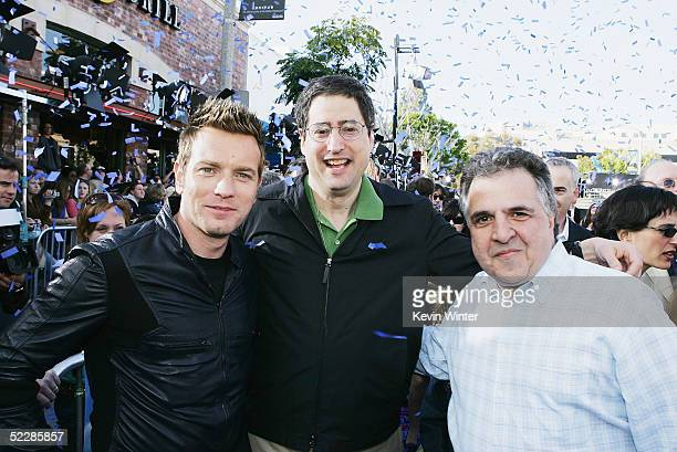 Actor Ewan McGregor Fox's Tom Rothman and Jim Gianopulos pose at the premiere of Twentieth Century Fox's 'Robots' at the Village Theater on March 6...