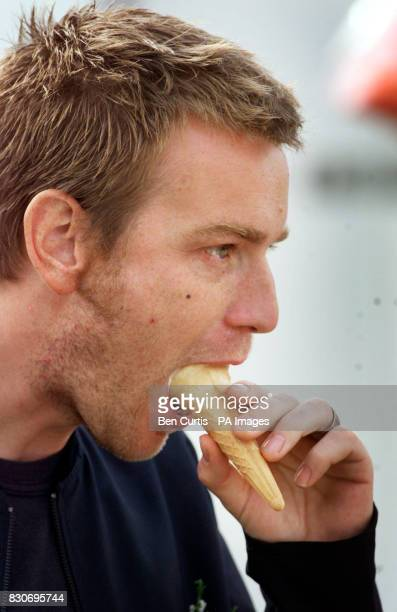 Actor Ewan McGregor licks an icecream at the 160th Lonach Highland Gathering at Strathdon near Balmoral in Scotland Stars Robin Williams and Billy...