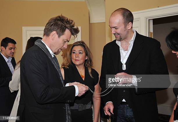 Actor Ewan McGregor receives a gift from a guest at the cocktail party for 'Love' for the Seattle International Film Festival at the Sorento Hotel on...