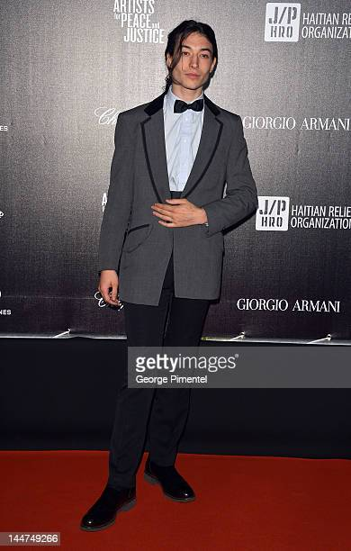 Actor Ezra Miller attends the Haiti Carnival In Cannes Benefitting J/P HRO Artists For Peace and Justice Happy Hearts Fund Presented By Armani during...