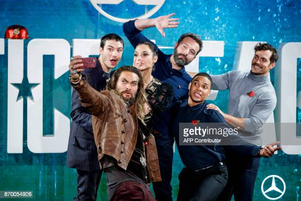 US actor Ezra Miller US actor Jason Momoa Israeli actress Gal Gadot US actor Ben Affleck US actor Ray Fisher and British actor Henry Cavill pose for...