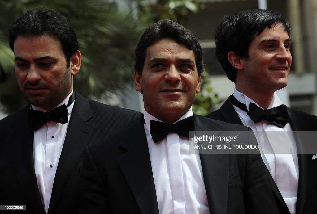 Actor Fadi Abi Samra (C) and Christoph Bach arrive for the screening of 'Carlos' presented out of competition at the 63rd Cannes Film Festival on May 19, 2010 in Cannes.