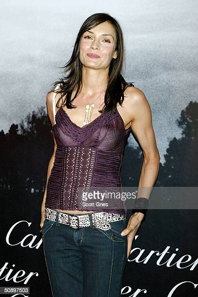 Actor Famke Janssen arrives at Santos Night the 100 Year Anniversary of the Cartier Santos Watch at The Armory May 25 2004 in New York City