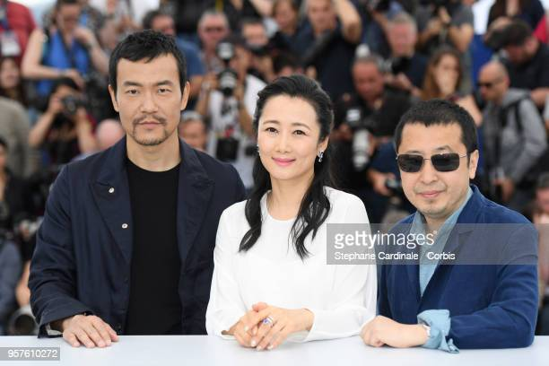 Actor Fan Liao actress Tao Zha and director Zhangke Jia attend the photocall for 'Ash Is The Purest White ' during the 71st annual Cannes Film...