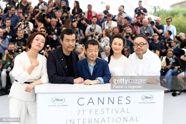 Actor Fan Liao director Zhangke Jia actress Tao Zha and actor Yibai Zhang attend the photocall for 'Ash Is The Purest White ' during the 71st annual...