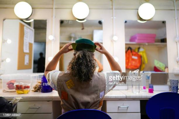 Actor Faye Campbell adjusts her hat as she prepares to play the character of the Hero in Jack and the Beanstalk at York Theatre Royal on December 02,...
