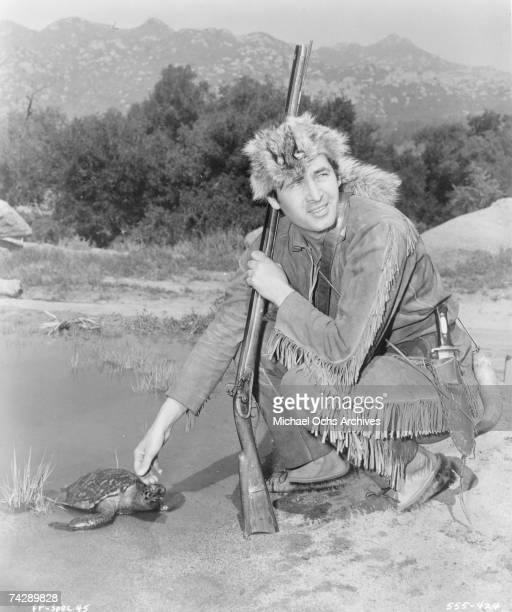 Actor Fess Parker poses in character as Davy Crockett circa 1955