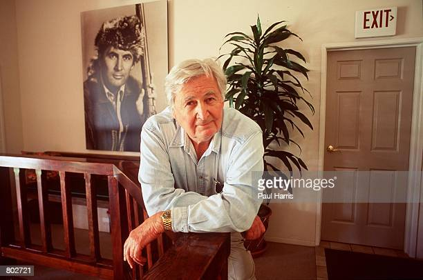 """Actor Fess Parker who starred in Disney's """"Davy Crockett"""" series in the 1950's at his home May 25, 2000 in Los Olivos, CA., behind him is a portrait..."""