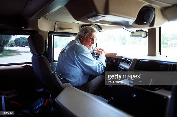 Actor Fess Parker who starred in Disney's Davy Crockett series in the 1950's drives around in his Hummer May 25 2000 in Los Olivos CA