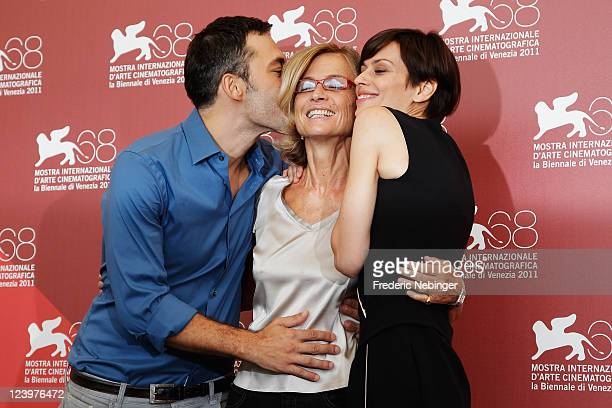 Actor Filippo Timi director Cristina Comencini and actress Claudia Pandolfi pose at the Quando La Notte photocall during the 68th Venice Film...