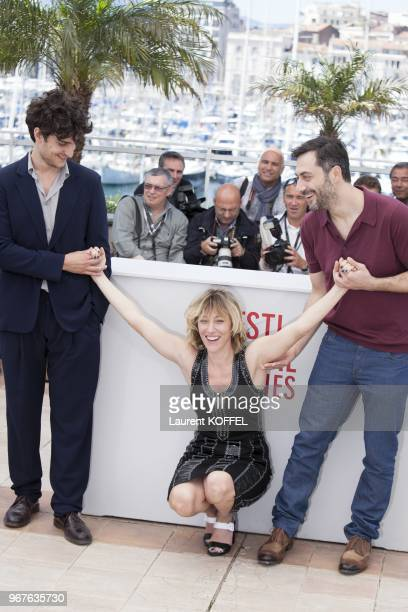 Actor Filippo Timi, director Valeria Bruni Tedeschi and actor Louis Garrel attend the photocall for 'Un Chateau En Italie' during The 66th Annual...