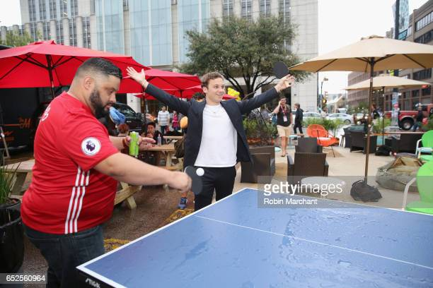 Actor Finn Cole plays table tennis with a guest during TNT Animal Kingdom at SXSW 2017 on March 11 2017 in Austin Texas