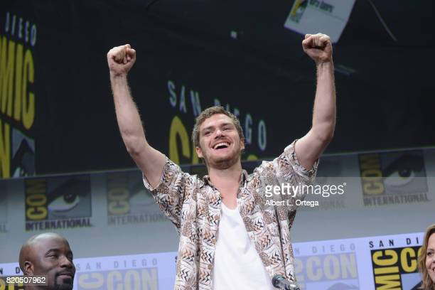 Actor Finn Jones walks onstage at Netflix's 'The Defenders' panel during ComicCon International 2017 at San Diego Convention Center on July 21 2017...