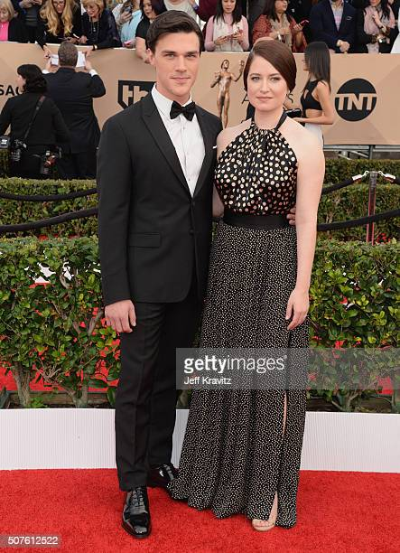 Actor Finn Wittrock and Sarah Roberts attend the 22nd Annual Screen Actors Guild Awards at The Shrine Auditorium on January 30 2016 in Los Angeles...