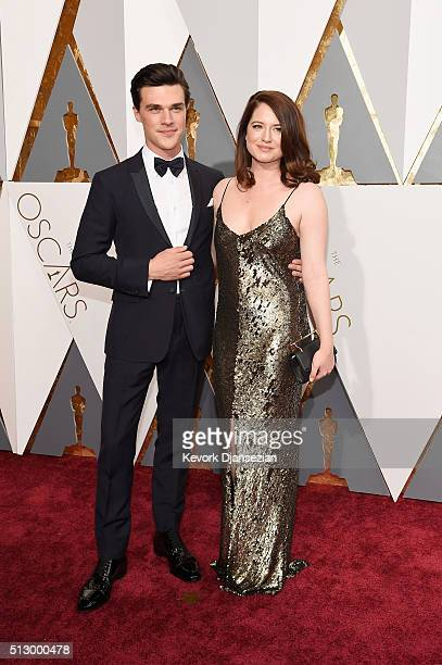 Actor Finn Wittrock and Sarah Roberts attend the 88th Annual Academy Awards at Hollywood Highland Center on February 28 2016 in Hollywood California