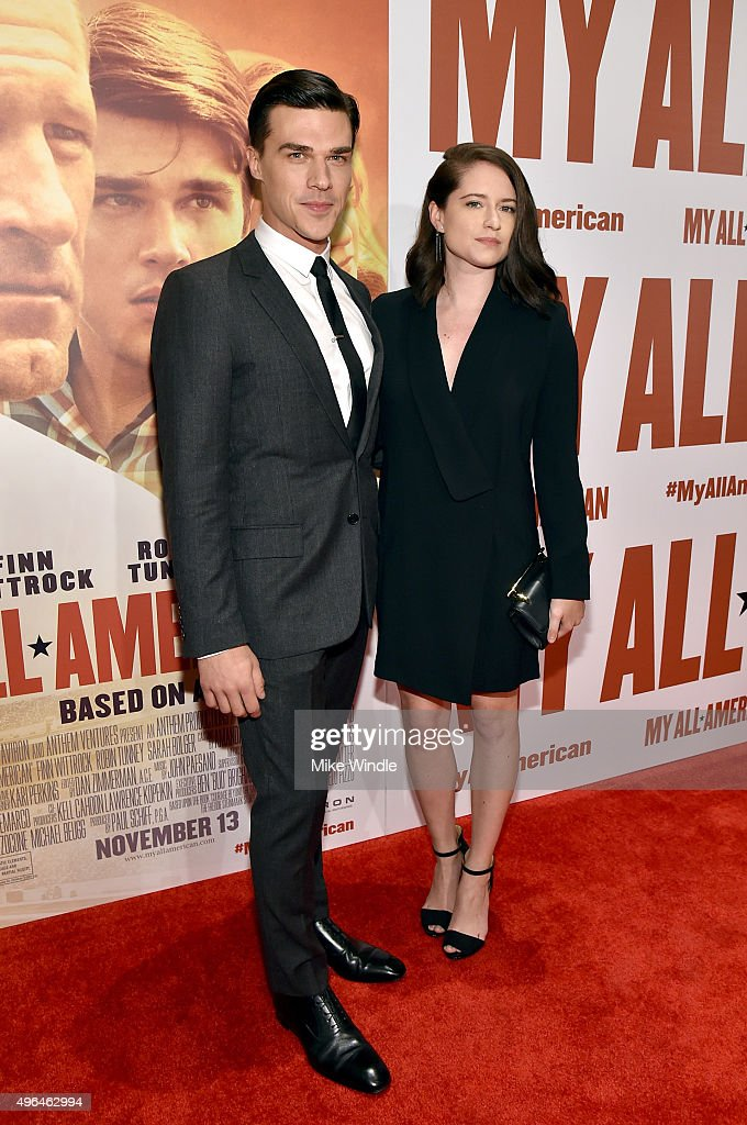 Actor Finn Wittrock (L) and Sarah Roberts attend the premiere of Clarius Entertainment's 'My All American' at The Grove on November 9, 2015 in Los Angeles, California.