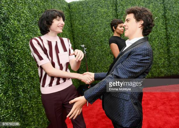 Actor Finn Wolfhard and Jack Dylan Grazer attends the 2018 MTV Movie And TV Awards at Barker Hangar on June 16 2018 in Santa Monica California
