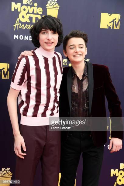 Actor Finn Wolfhard and Noah Schnapp attend the 2018 MTV Movie And TV Awards at Barker Hangar on June 16 2018 in Santa Monica California