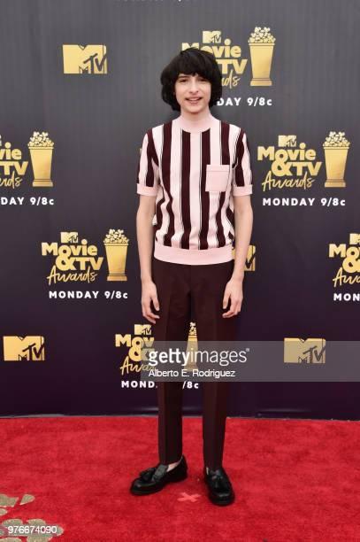 Actor Finn Wolfhard attends the 2018 MTV Movie And TV Awards at Barker Hangar on June 16 2018 in Santa Monica California