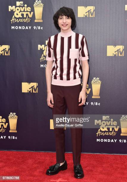 Actor Finn Wolfhard attends the 2018 MTV Movie And TV Awards at Barker Hangar on June 16 2018 in Santa Monica California