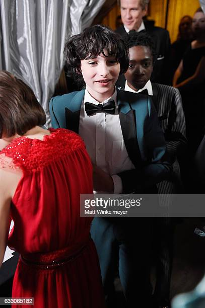 Actor Finn Wolfhard winner of the Outstanding Ensemble in a Drama Series award of 'Stranger Things' in the trophy room during The 23rd Annual Screen...