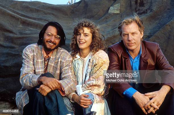 Actor Fisher Stevens actress Cynthia Gibb and actor Michael McKean pose on set of the movie Short Circuit 2 circa 1988
