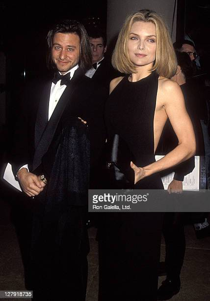 Actor Fisher Stevens and actress Michelle Pfeiffer attend the 49th Annual Golden Globe Awards on January 18 1992 at Beverly Hilton Hotel in Beverly...