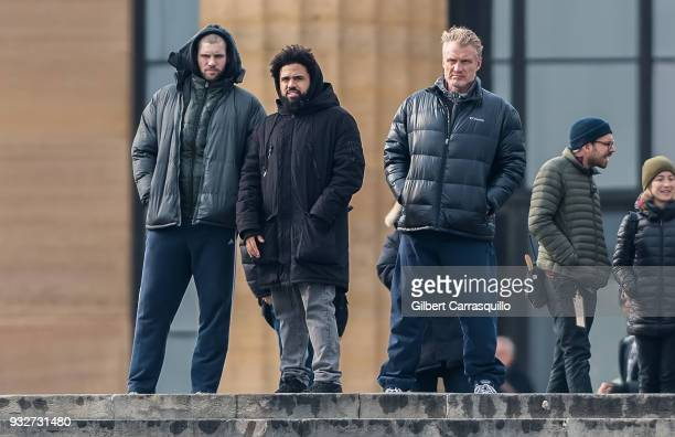 Actor Florian Munteanu director Steven Caple Jr and actor Dolph Lundgren are seen on set filming 'Creed II' at the Rocky Statue and the 'Rocky Steps'...