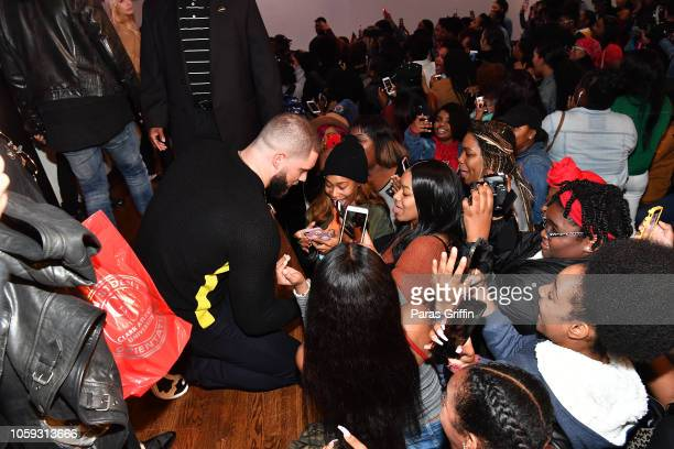 Actor Florian Munteanu take selfie with Clark Atlanta University students during the Creed 2 Clark Atlanta University Student Forum at Clark Atlanta...