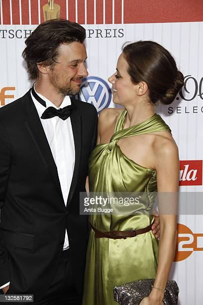 Actor FlorianDavid Fitz and Anja Knauer arrive for the German Film Award 2011 at Friedrichstadtpalast on April 8 2011 in Berlin Germany
