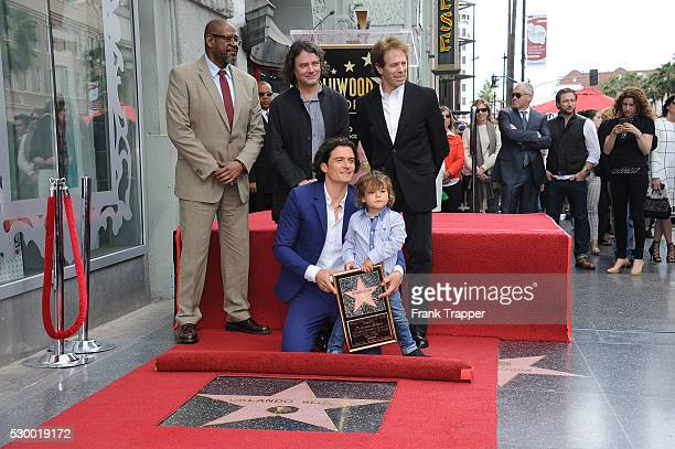 Actor Forest Whitaker actor Orlando Bloom and son Flynn director David Leveaux and producer Jerry Bruckheimer pose at the ceremony that honored him...
