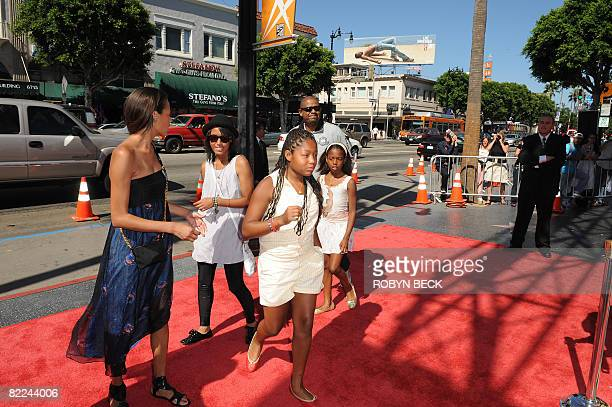 Actor Forest Whitaker and his wife Keisha arrive with their children for the premiere of Star Wars The Clone Wars at the Egyptian Theatre in...